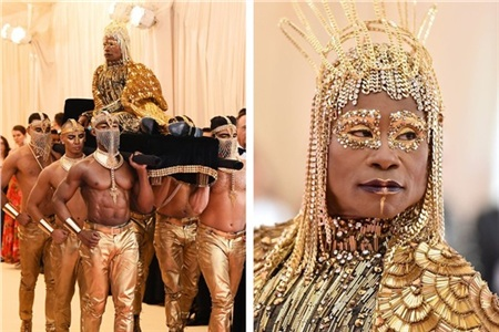 Không ai có cách thức tiến vào bảo tàng Met một cách ấn tượng hơn Billy Porter. Ông được 6 nam thần rước tới, rồi sau đó xoe đôi cánh khổng lồ của bộ trang phục dát vàng.