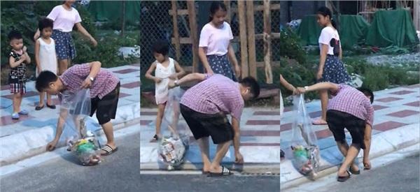 Clip: Ông bố cùng các con vừa đi bộ vừa nhặt rác trên đường, ai xem xong cũng phải thốt lên 'Phải làm theo thôi!' 0