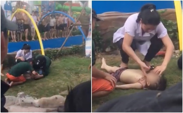 Em bé được người lớn sơ cứu sau sự cố - Ảnh cắt từ clip